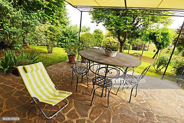 Wrought-iron round table with chairs, covered garden corner