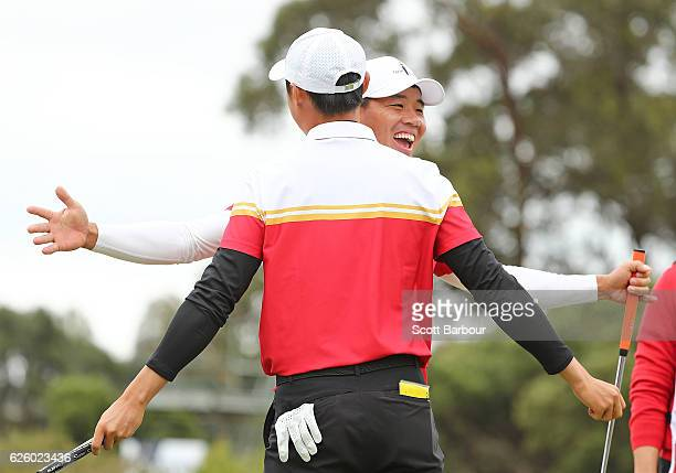 Wu Ashun and Haotong Li of China celebrate a birdie during day four of the World Cup of Golf at Kingston Heath Golf Club on November 27 2016 in...