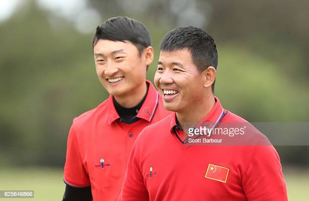 Wu Ashun and Haotong Li of China celebrate after finishing their round during day two of the World Cup of Golf at Kingston Heath Golf Club on...