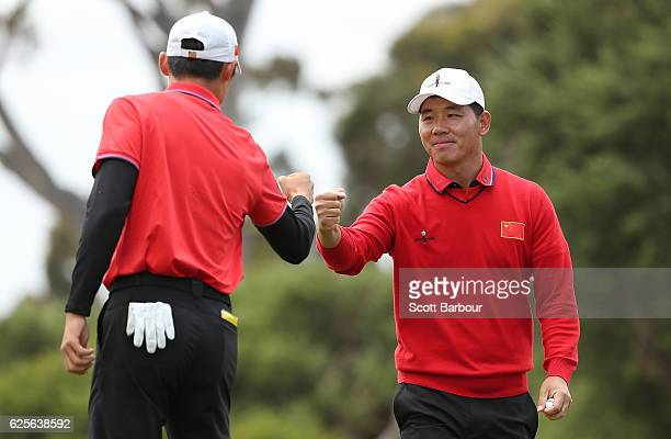Wu Ashun and Haotong Li of China celebrate on the 4th hole during day two of the World Cup of Golf at Kingston Heath Golf Club on November 25 2016 in...
