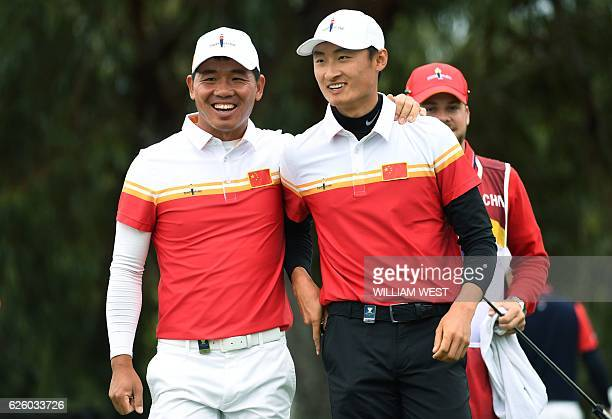 Wu Ashun of China and teammate Li Haotong react during the final day of the World Cup of Golf on the Kingston Heath course in Melbourne on November...