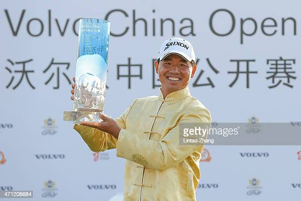 Wu Ashun of China holds the trophy after winning the Volvo China Open at Tomson Shanghai Pudong Golf Club on April 26 2015 in Shanghai China
