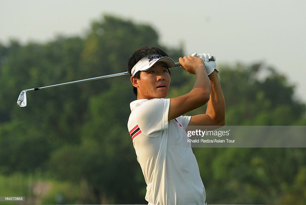 Wu Ashun of China plays a shot during round two of the Maybank Malaysian Open at Kuala Lumpur Golf & Country Club on March 22, 2013 in Kuala Lumpur, Malaysia.