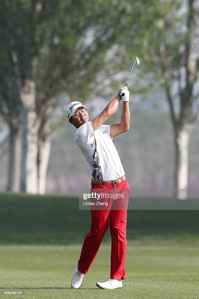 Wu Ashun of China plays a shot during the second round of the Volvo China open at Topwin Golf and Country Club on April 30, 2016 in Beijing, China.