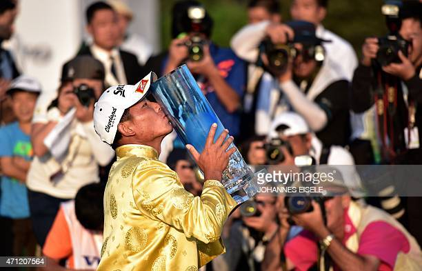 Wu Ashun of China poses with the trophy after winning the Volvo China Open golf tournament in Shanghai on April 26 2015 AFP PHOTO / JOHANNES EISELE