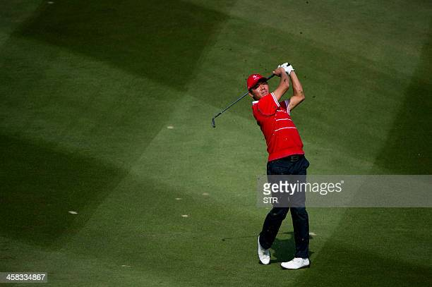 Wu Ashun of China takes a shot as he partners Liang Wenchong to half with the European team's David Howell/Marc Warren on the secondday of the...