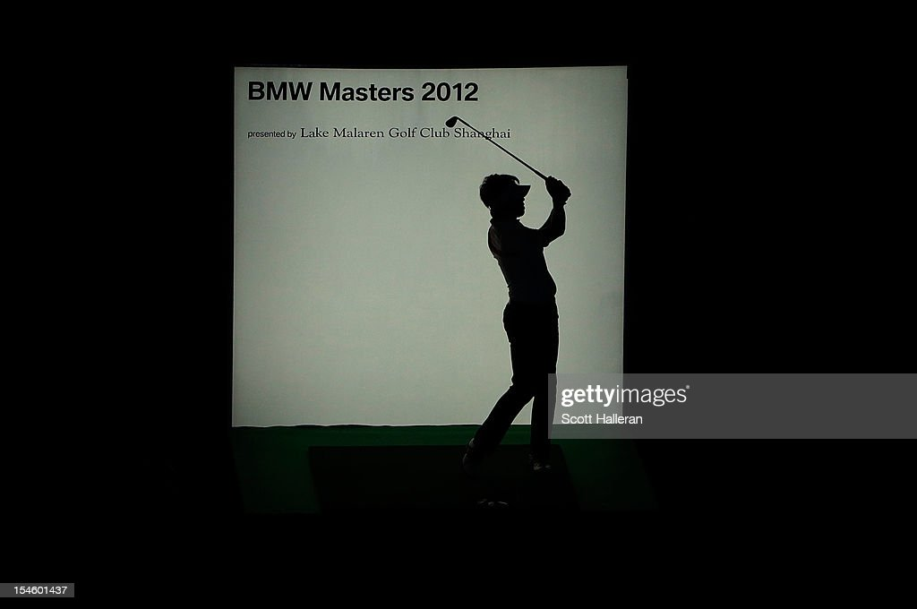 Wu A-shun of China watches a shot during the opening night gala prior to the start of the BMW Masters at the Lake Malaren Golf Club on October 23, 2012 in Shanghai, China.