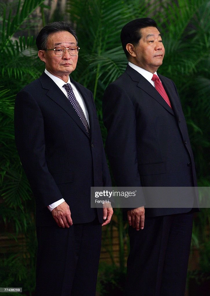 Wu Bangguo and Jia Qinglin one of the members of new nineseat Politburo Standing Committee greets the media at the Great Hall of the People on...