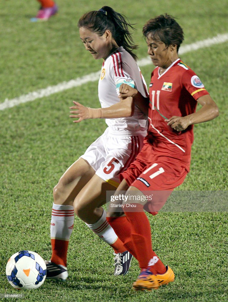 Wu Haiyan of China battles with Khin Moe Wai of Myanmar during the AFC Women's Asian Cup Group B match between Myanmar and China at Thong Nhat Stadium on May 17, 2014 in Ho Chi Minh City, Vietnam.