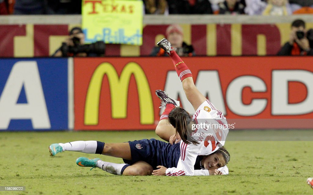 Wu Haiyan (26)of China lands on top of Alex Morgan (13)in the second half at BBVA Compass Stadium on December 12, 2012 in Houston, Texas. USA won 4-0. (Photo by Bob Levey/Getty Images) *** Alex Morgan and Wu Haiyan