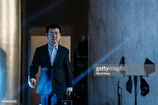 Wu Jihan cofounder of Bitmain Technologies Ltd walks on stage to speak at the Shape the Future Blockchain Global Summit in Hong Kong China on...