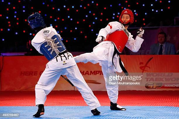 Wu Jingyu of China and Chanatip Sonkham of Thailand compete in Seniors Female A 49kg Final during the World Taekwondo Grand Prix held at the...