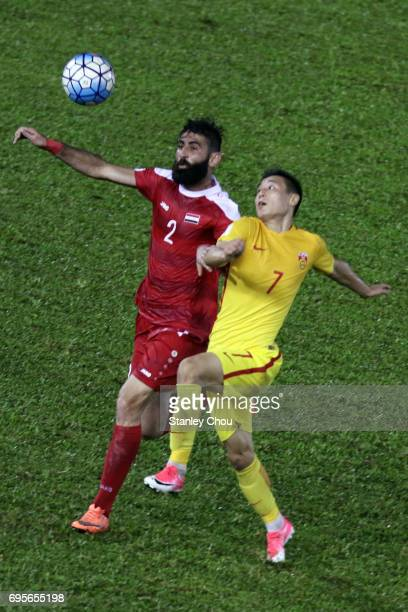 Wu Lei of China battles with Ahmad Al Saleh of Syria during the 2018 FIFA World Cup Asian Qualifier Group A Final Round match between Syria and China...