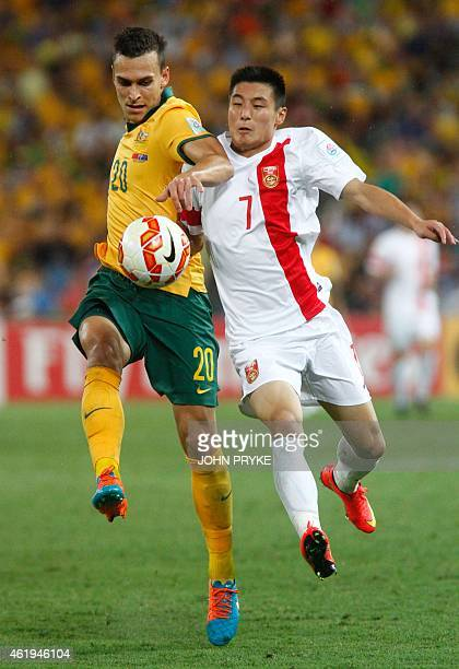 Wu Lei of China fights for the ball with Trent Sainsbury of Australia during the AFC Asian Cup quarterfinal football match between Australia and...