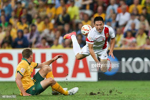 Wu Lei of China is stumbled during the 2015 Asian Cup match between China PR and the Australian Socceroos at Suncorp Stadium on January 22 2015 in...