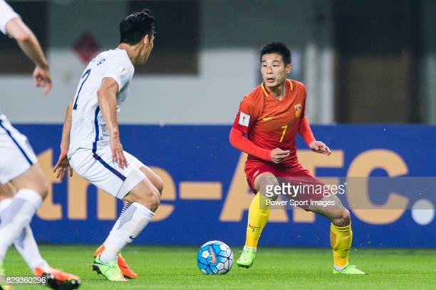 Wu Lei of China PR fights for the ball with Lee Yong of Korea Republic during their 2018 FIFA World Cup Russia Final Qualification Round Group A...