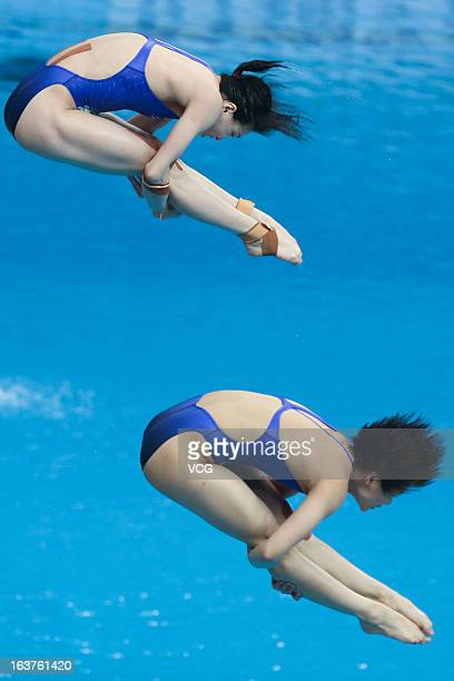 Wu Minxia and Shi Tingmao of China compete in the Women's 3m Springboard Synchro Final during day one of the FINA Diving World Series Beijing Station...
