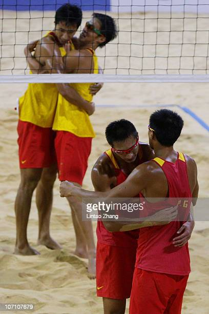 Wu Penggen of China celebrates with team mate Xu Linyin after winning the men's Gold Medal match against Gao Peng and Li Jian of China at the Beach...