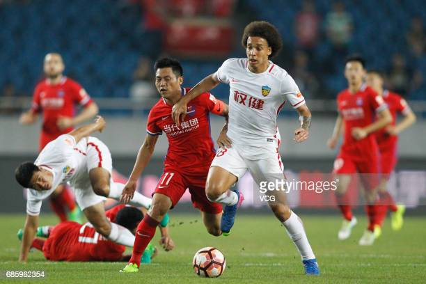 Wu Qing of Chongqing Lifan and Axel Witsel of Tianjin Quanjian compete for the ball during the 10th round match of 2017 Chinese Football Association...
