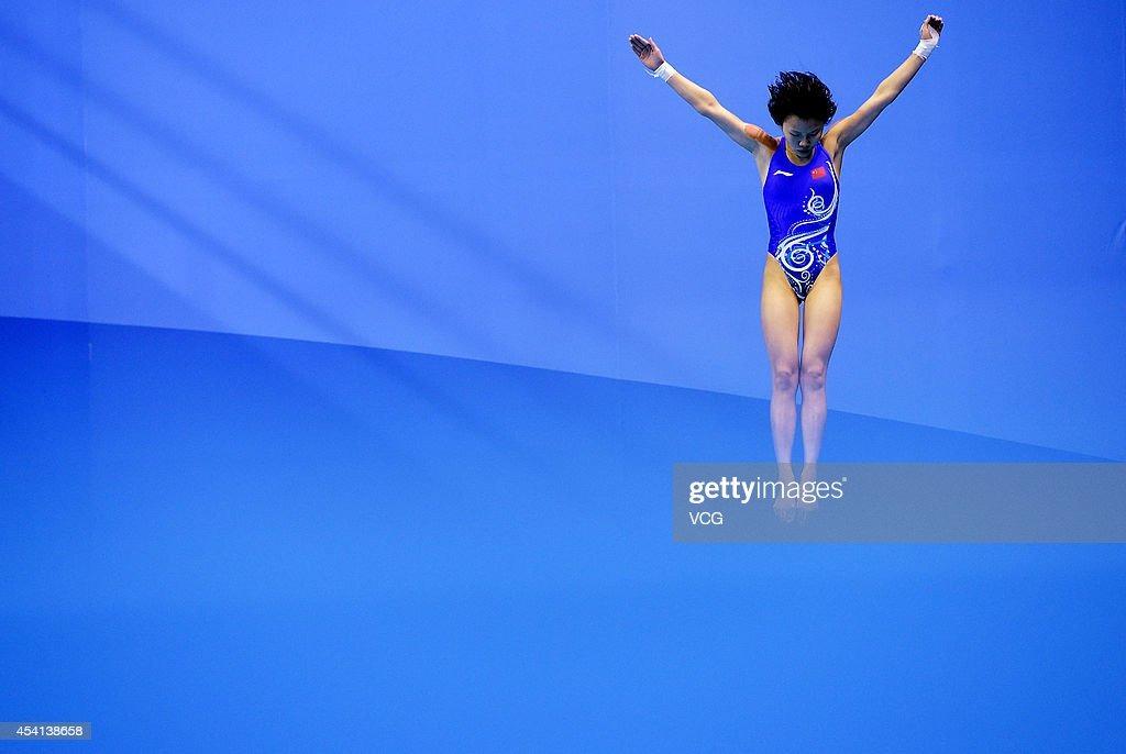 Wu Shengping of China competes in the Women's 3m Springboard Final on day nine of the Nanjing 2014 Summer Youth Olympic Games at Nanjing OSC Natatorium on August 25, 2014 in Nanjing, China.