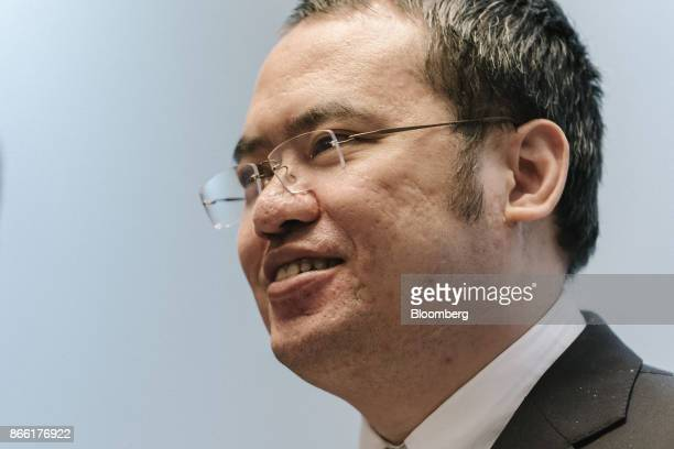 Wu Wenhui cochief executive officer and executive director of China Literature Ltd reacts as he poses for photographs ahead of a news conference in...