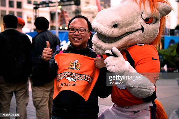 Wu Wgi of China with Broncos fans gathering at Union Square with Miles the Mascot in San Francisco CA February 03 2016