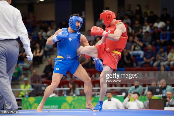 4th Islamic Solidarity Games Azerbaijan Parviz Abdullayev in action vs Turkey Ismail Uzuner during Men's 75 kg Quarterfinals at Baku Sports Hall Baku...
