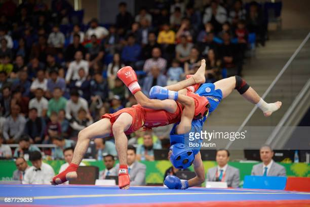 4th Islamic Solidarity Games Jordan Hamza Yahia in action vs Turkmenistan Annageldi Agamyradov during Men's 56 kg Quarterfinals at Baku Sports Hall...