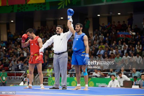 4th Islamic Solidarity Games Referee raises the arm of Azerbaijan Ruslan Piraliyev vs Pakistan Abdullah Abdullah during Men's 60 kg Quarterfinals at...