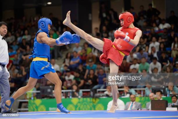 4th Islamic Solidarity Games Turkey Ibrahim Sapaloglu in action vs Indonesia Yusaf Widiyanto during Men's 56 kg Quarterfinals at Baku Sports Hall...