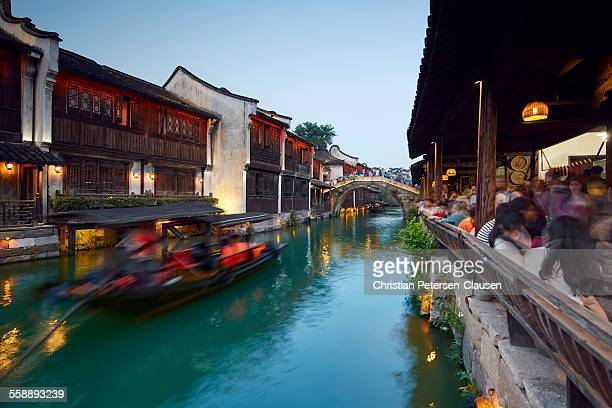 Wuzhen tourists at canal with gondola