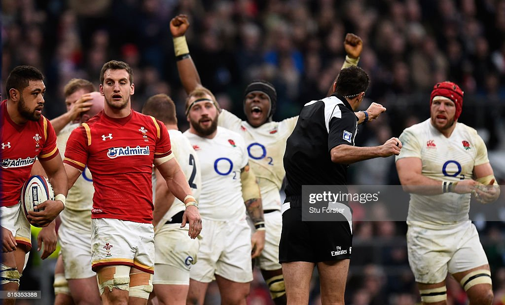 Wwales captain <a gi-track='captionPersonalityLinkClicked' href=/galleries/search?phrase=Sam+Warburton&family=editorial&specificpeople=4234449 ng-click='$event.stopPropagation()'>Sam Warburton</a> (2nd l) reacts as <a gi-track='captionPersonalityLinkClicked' href=/galleries/search?phrase=Maro+Itoje&family=editorial&specificpeople=5967858 ng-click='$event.stopPropagation()'>Maro Itoje</a> celebrates after England had won a penalty at the scrum during the RBS Six Nations match between England and Wales at Twickenham Stadium on March 12, 2016 in London, England.