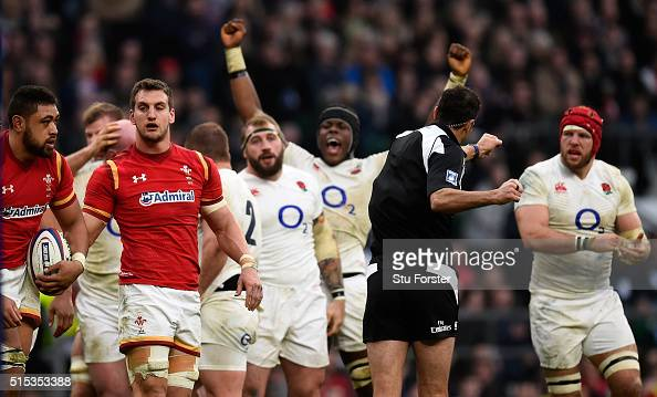 Wwales captain Sam Warburton reacts as Maro Itoje celebrates after England had won a penalty at the scrum during the RBS Six Nations match between...