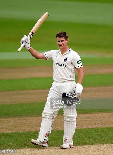 Wwarwickshire batsman Sam Hain celebrates after reaching his century during day three of the LV County Championship Division One match between...