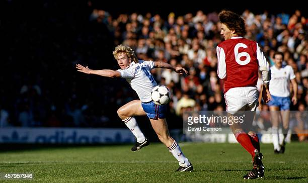 Wwest Ham striker Frank McAvennie turns Arsenal defender Tony Adams during a League Division One match between Arsenal and West Ham United at...