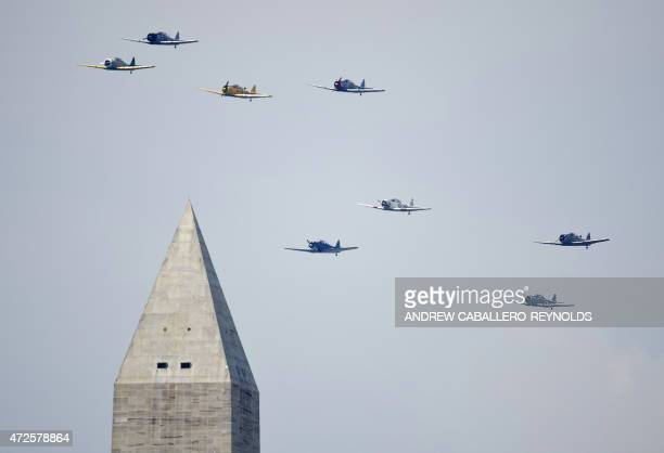 WWIIera planes fly over the Washington Monument during the Arsenal of Democracy a WWII plane flyover for the 70th anniversary of VE Day in Washington...