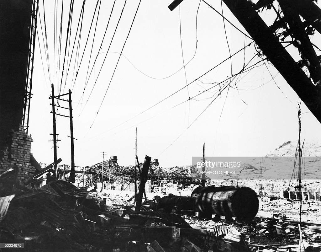 WWIIhistorynuclearNagasaki This file photo taken in 1945 next to the Urakami river in Nagasaki shows a wrecked brick wall and a 'Mitsubishi' steel...
