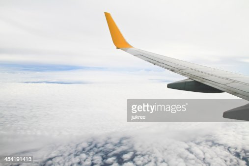 WWing of the plane on sky background : Stock Photo