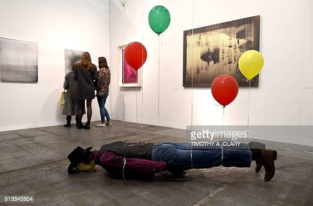 'Wyatt and Sky' by artist Sislej Xfafa during the VIP opening of The Armory Show 2016 in New York March 2 2016 / AFP / Timothy A CLARY / RESTRICTED...