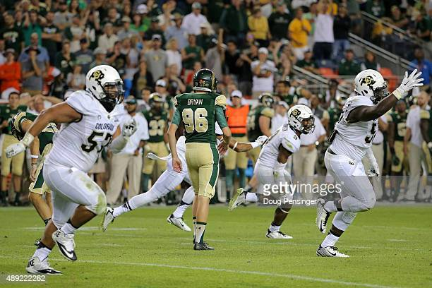 Wyatt Bryan of the Colorado State Rams walks off the field as the Colorado Buffaloes celebrate after Tedric Thompson of the Colorado Buffaloes...