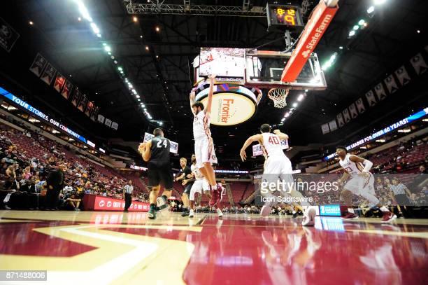 Wyatt Wilkes forward Florida State University Seminoles jumps in the path of Ivan Tomic guard Thomas University Night Hawks in an exhibition...