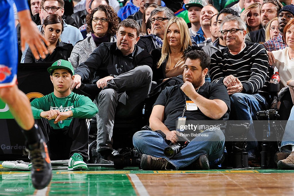 Wyc Grousbeck, a co-owner of the Boston Celtics, left, and his wife Corinne look on during a game between the Celtics and New York Knicks on January 24, 2013 at the TD Garden in Boston, Massachusetts.