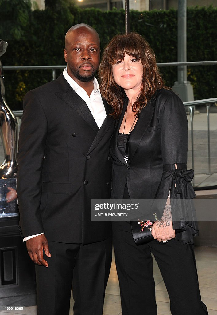 <a gi-track='captionPersonalityLinkClicked' href=/galleries/search?phrase=Wyclef+Jean&family=editorial&specificpeople=171115 ng-click='$event.stopPropagation()'>Wyclef Jean</a> (L) and Dana Foley attend the 2013 CFDA Fashion Awards on June 3, 2013 in New York, United States.