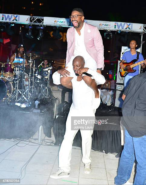 Wyclef Jean and DJ Irie on stage at the VIP KickOff Concert during the 11th Annual Irie Weekend at Kimpton Surfcomber Hotel on June 18 2015 in Miami...
