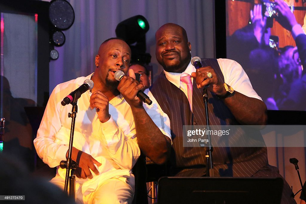 Wyclef Jean (L) and Shaquille O'Neal onstage at Barry University's 75th Anniversary Birthday Bash at Soho Studios on October 3, 2015 in Miami, Florida.