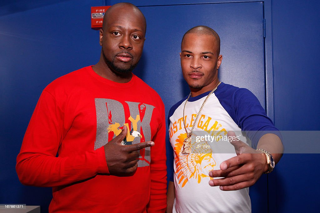 <a gi-track='captionPersonalityLinkClicked' href=/galleries/search?phrase=Wyclef+Jean&family=editorial&specificpeople=171115 ng-click='$event.stopPropagation()'>Wyclef Jean</a> and <a gi-track='captionPersonalityLinkClicked' href=/galleries/search?phrase=T.I.&family=editorial&specificpeople=221599 ng-click='$event.stopPropagation()'>T.I.</a> visit BET's 106 & Park at BET Studios on May 1, 2013 in New York City.