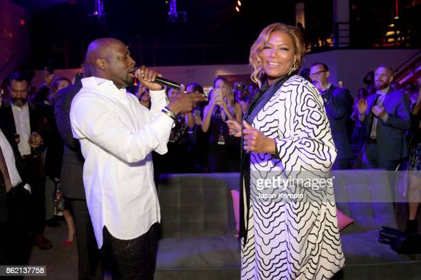 Wyclef Jean sings to Queen Latifah at VH1 Save The Music 20th Anniversary Gala at SIR Stage37 on October 16 2017 in New York City