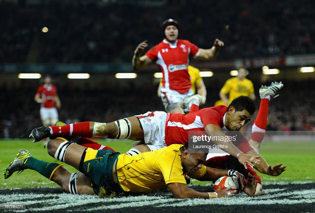 <a gi-track='captionPersonalityLinkClicked' href=/galleries/search?phrase=Wycliff+Palu&family=editorial&specificpeople=546321 ng-click='$event.stopPropagation()'>Wycliff Palu</a> of Australia dives to save a certain try from <a gi-track='captionPersonalityLinkClicked' href=/galleries/search?phrase=Toby+Faletau&family=editorial&specificpeople=6522513 ng-click='$event.stopPropagation()'>Toby Faletau</a> of Wales during the International match between Wales and Australia at Millennium Stadium on December 1, 2012 in Cardiff, Wales.