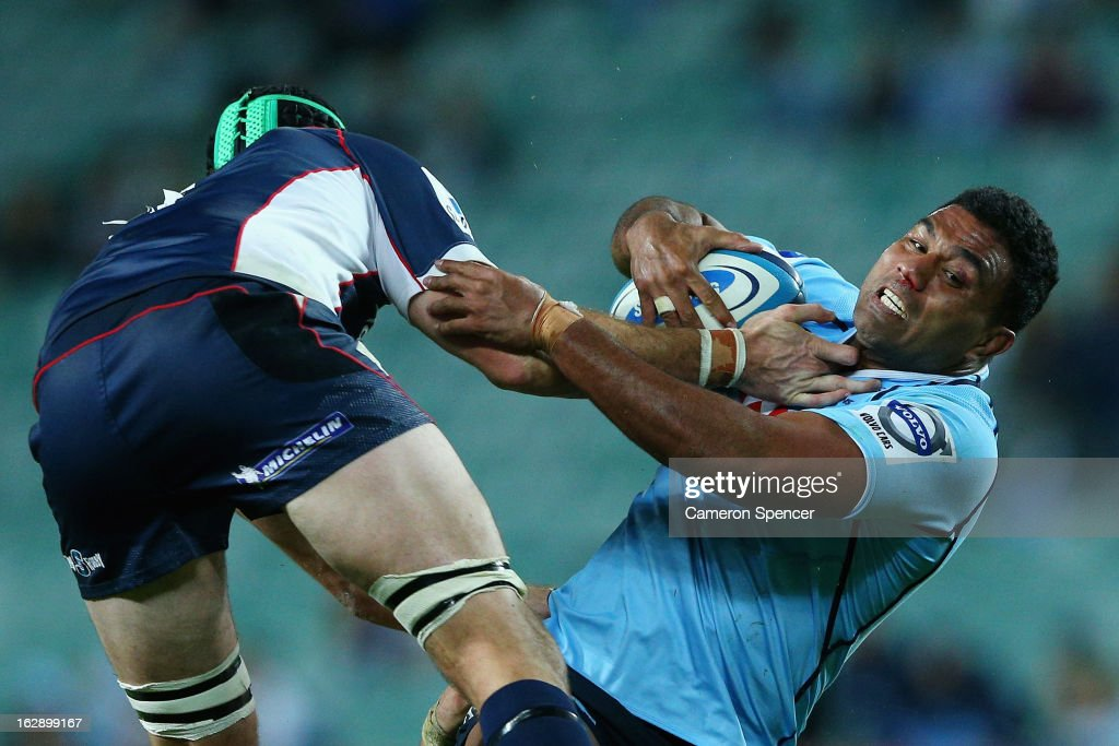 <a gi-track='captionPersonalityLinkClicked' href=/galleries/search?phrase=Wycliff+Palu&family=editorial&specificpeople=546321 ng-click='$event.stopPropagation()'>Wycliff Palu</a> of the Waratahs is tackled during the round three Super Rugby match between the Waratahs and the Rebels at Allianz Stadium on March 1, 2013 in Sydney, Australia.