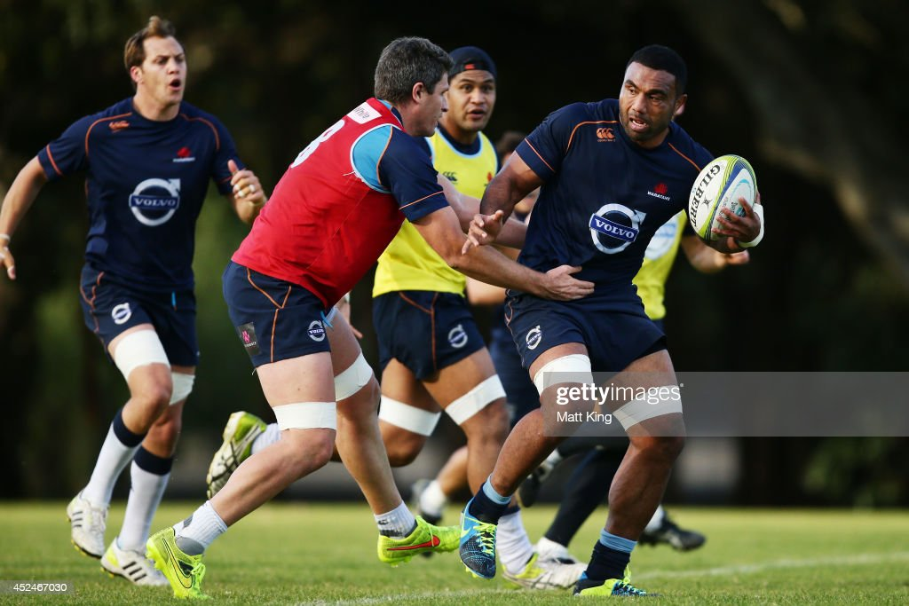 Wycliff Palu of the Waratahs runs with the ball during a Waratahs Super Rugby training session at Moore Park on July 21, 2014 in Sydney, Australia.